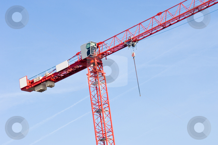 Hi Tower Crane stock photo, A red , high, building crane against a blue sky by Corepics VOF