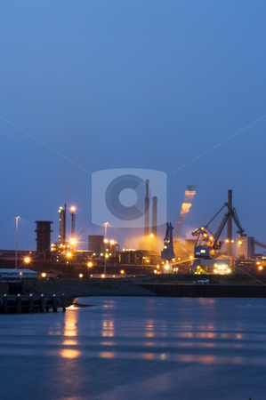 Industrial activityy at night stock photo, A crane moving in a steel plant at night by Corepics VOF