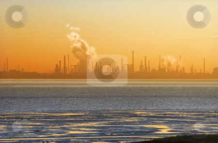 Chemical sunset stock photo, The silhouette of a chemical plant across a sea arm during sunset by Corepics VOF