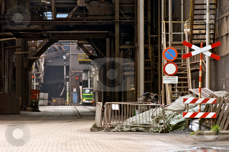 Industrial alley stock photo, A dimly lit alley at a heavy industry plant by Corepics VOF