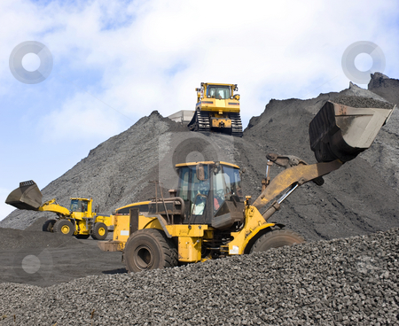 Mining operations stock photo, Three huge shovels at work in a large coal field by Corepics VOF