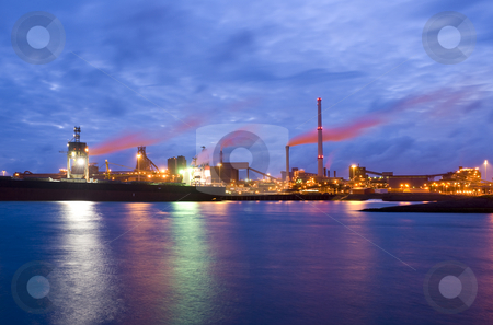 Steel plant at night stock photo, The front-end of a steel plant, with a bulk carrier with iron ore being unloaded by Corepics VOF