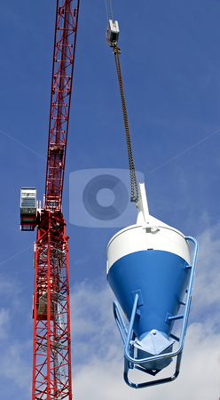 High rise Crane and Concrete mixer stock photo, The red construction beams of a high rise crane, with a pully and a concrete mixer attached, used in the building industry by Corepics VOF