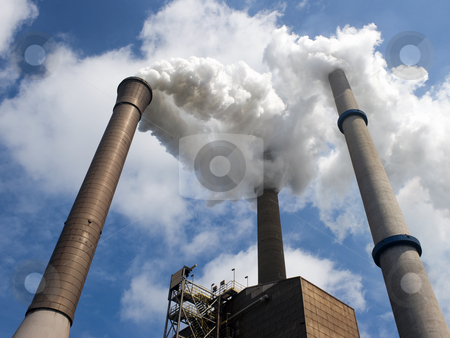 Three Smoke Stacks in perspective stock photo, Three smoke stacks, emitting steam, with a centered and vertical vanishing point by Corepics VOF