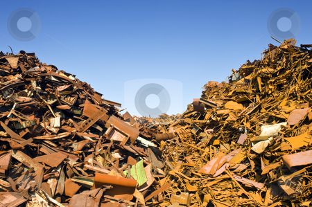 Scrap Heap Waste Separation stock photo, Two heaps of different kinds of metal scrap in a scrap yard by Corepics VOF