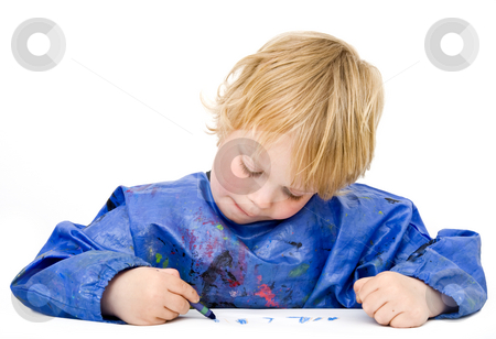 Drawing stock photo, Young boy concentrating on his drawing by Corepics VOF