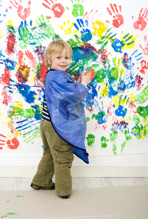 Finger painting stock photo, A young boy enjoying himself at fingerpainting by Corepics VOF