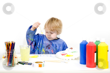 Young painter stock photo, A young boy making a painting with poster paint by Corepics VOF