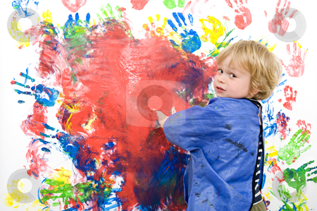 Messing about with finger paint stock photo, Young boy messing about with finger paint by Corepics VOF