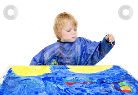 Painter boy stock photo, A young boy making a big painting on a table by Corepics VOF