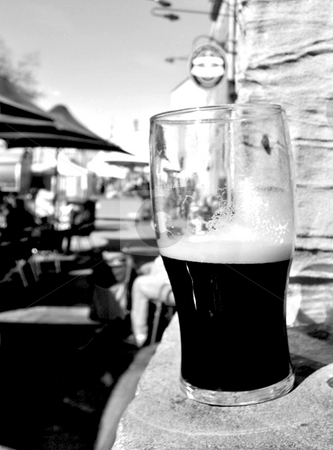 A Nice Cold One stock photo, My glass [of stout] is 'half-full... The streetside view of Salamanca Place, Tasmania. by Stephen Kerin