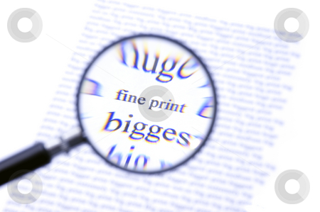 Paying attention to the fine print stock photo, A magnifying glass, zooming in on the text Fine Print on a sheet of paper, surrounded by bigger letters. The chromatic aberation of the cheap magnifying glass with its plastic lense is intentional. by Corepics VOF