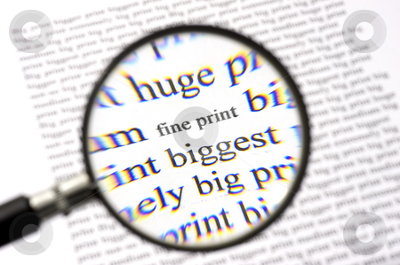 Reading the Fine Print stock photo, A magnifying glass, zooming in on the text Fine Print on a sheet of paper, surrounded by bigger letters. The chromatic aberation of the cheap magnifying glass with its plastic lense is intentional. by Corepics VOF