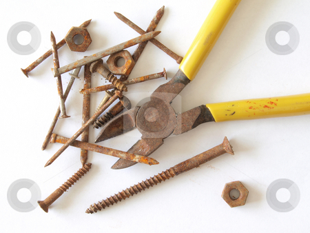 Rusty tools and fixings.  stock photo, Rusty tools, screws, nails, nuts and bolts. by Ian Langley