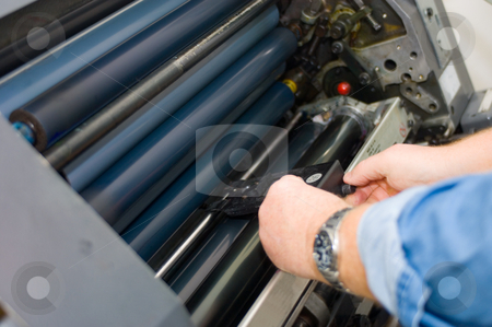 Sheet feeder adjustment stock photo, Adjusting the sheet feeder height of a printing press by Corepics VOF