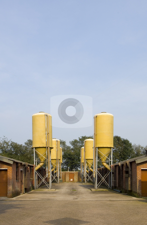 Agricultural silos stock photo, Industrial silos on a pig farm by Corepics VOF