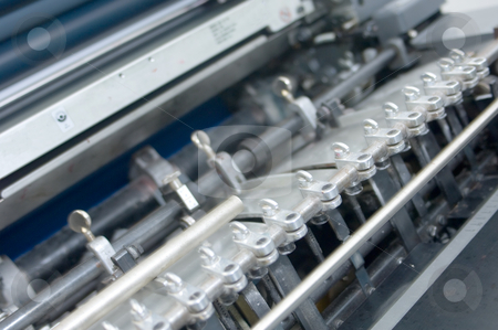 Detail of a printing press 1 stock photo, Detail of the sheet feeder of an offset printing press by Corepics VOF