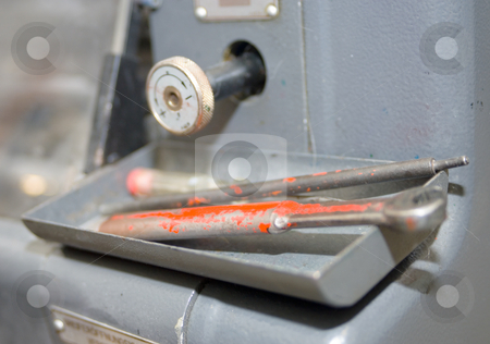 Essential tools stock photo, Tools on an offset printing press and a control knob. by Corepics VOF