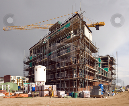 Housing development stock photo, A huge housing development, erecting a complete city by Corepics VOF