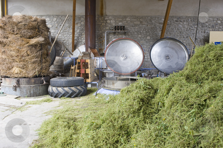 Herbal essences distillery stock photo, The herbal essences distillery, with a heap of thyme in the foreground, the pressure cookers, used to distill the essences, with their open lids and a bale of lavender on the right by Corepics VOF