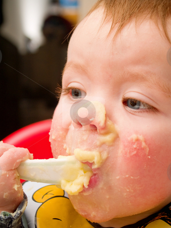 Messy baby Boy eating mashed potato stock photo, Messy baby Boy eating mashed potato with spoon by Phillip Dyhr Hobbs