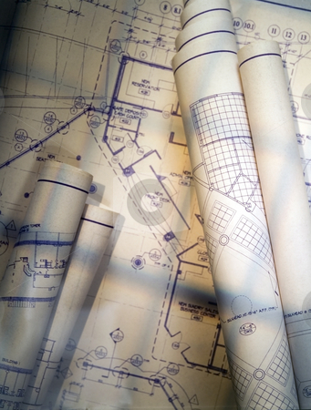 Blueprints stock photo, Blueprints rolled and unrolled illuminated with window light by Jonathan Hull