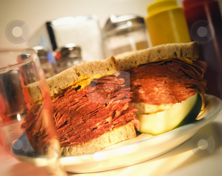 Corned beef on rye stock photo, Corned beef sandwich on rye in a diner setting by Jonathan Hull