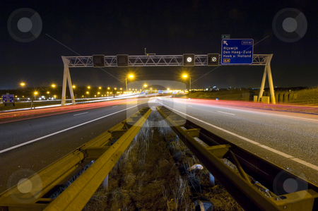 Motorway Junction stock photo, Two motorway lanes merging into one by Corepics VOF