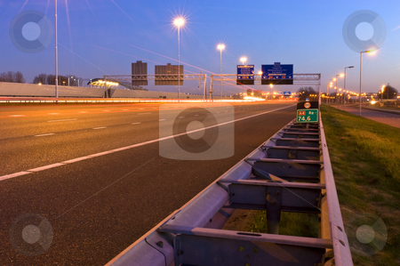Motorway Information System stock photo, The viaducts of a motorway junction at night by Corepics VOF