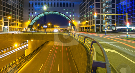 Inner City fly over stock photo, A roundabout, surrounded by office buildings on top of a multiple lane highway by Corepics VOF