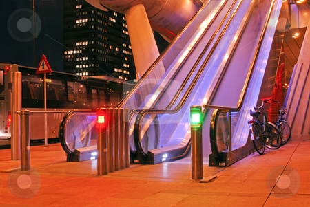 Escalators stock photo, Escalators, bus and bicycle at the modern, futuristic looking entrance of a tram station by Corepics VOF