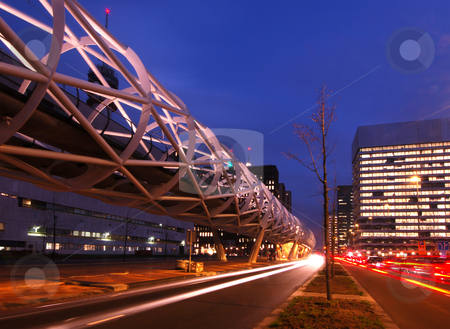 Elevated Tram structure stock photo, The modern looking, futuristic looking, elevated tram line in the Hague, the Netherlands at night by Corepics VOF