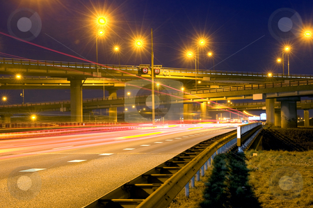 Highway Junction stock photo, Cars, racing past a huge highway junction at night by Corepics VOF