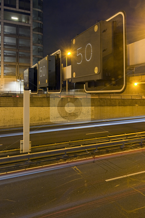 Motorway Information System stock photo, An overhead motorway information system warning drivers of a traffic jam ahead, setting the speed limit to 50 kilometers per hour by Corepics VOF