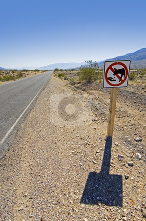 Death Valley road sign stock photo, Landscapes of Death Valley National Park, a warning sign not to feed the coyotes. by Corepics VOF