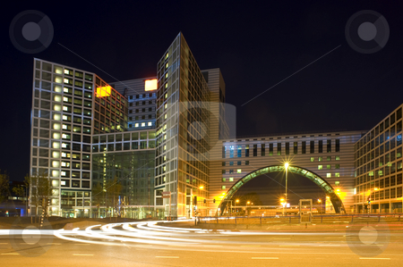 Corporate roundabout stock photo, The architure of modern corporate headquarters, situated on the edges of a huge roudabout at night by Corepics VOF
