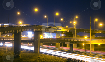 Motorway Junction stock photo, A motorway junction at night, with various fly-overs, crossing eachother by Corepics VOF