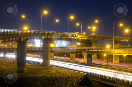 Motorway Overpass stock photo, A motorway junction at night, with various fly-overs, crossing eachother by Corepics VOF