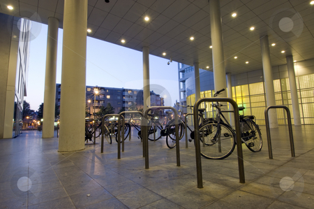 Bicycle parking stock photo, Parked bicycles at night by Corepics VOF