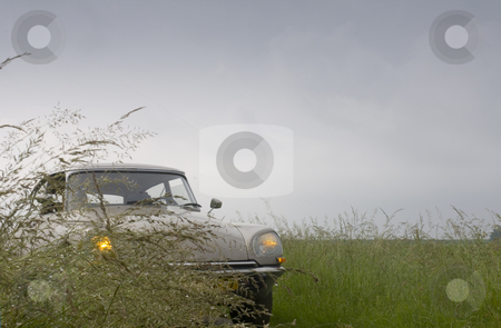 La Deesse on a rainy day stock photo, A classic 1973 French car parked on a country road on a rainy day in Zeeland, the Netherlands by Corepics VOF