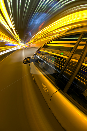Night time Driving stock photo, A car racing along a motorway, surrounded by streaks of light of overhead street lights and route information by Corepics VOF