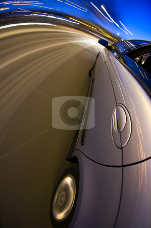 Around the bend stock photo, A car driving at high speed through a curved section of the motorway by Corepics VOF