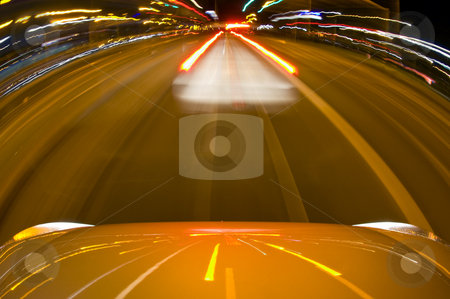 Breaking Car at night stock photo, A car, breaking to avoid a collision, closing rapidly in on the car in front of him. by Corepics VOF