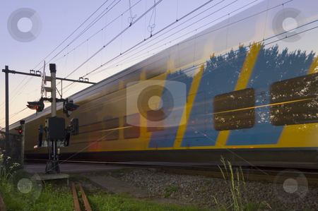 Passing train stock photo, A passing train at full speed during sunset by Corepics VOF
