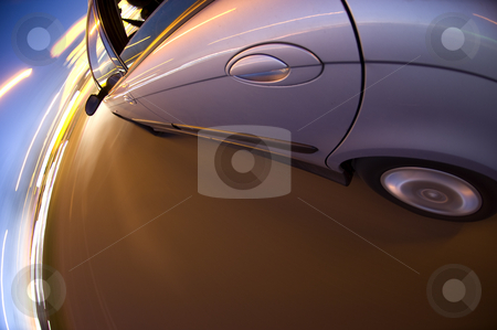 Around the bend stock photo, A car turning right at twilight on a busy street by Corepics VOF