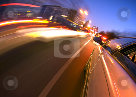 Downtown Driving stock photo, A car driving in the busy downtown streets, anticipating oncoming traffic by Corepics VOF