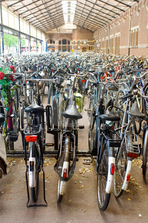 Railway Station Bicycle Parking stock photo, Rows and rows of bicycles parked at a railway station. by Corepics VOF