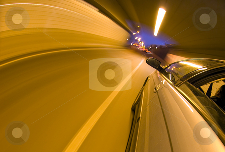 The end of a tunnel stock photo, A car speeding towards the exit of a tunnel by Corepics VOF