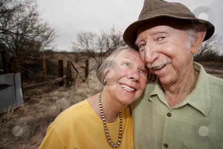 Happy Senior Couple Outdoors stock photo, Happy Senior Couple Outdoors Smiling and Embracing by Scott Griessel