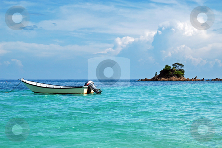 Boat and Island stock photo, Kapas Island by Norazshahir Razali